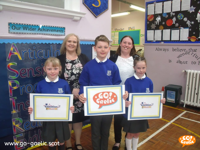 Proud finalists: Head teacher Alison McFarlane, back left, and teacher Rachel Neilly with, from left to right, pupils Paige Hamilton, Graham Forrester and Freya Hamilton.