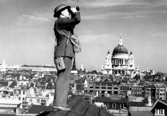 London Blitz - Soilder looking at sky through binoculars